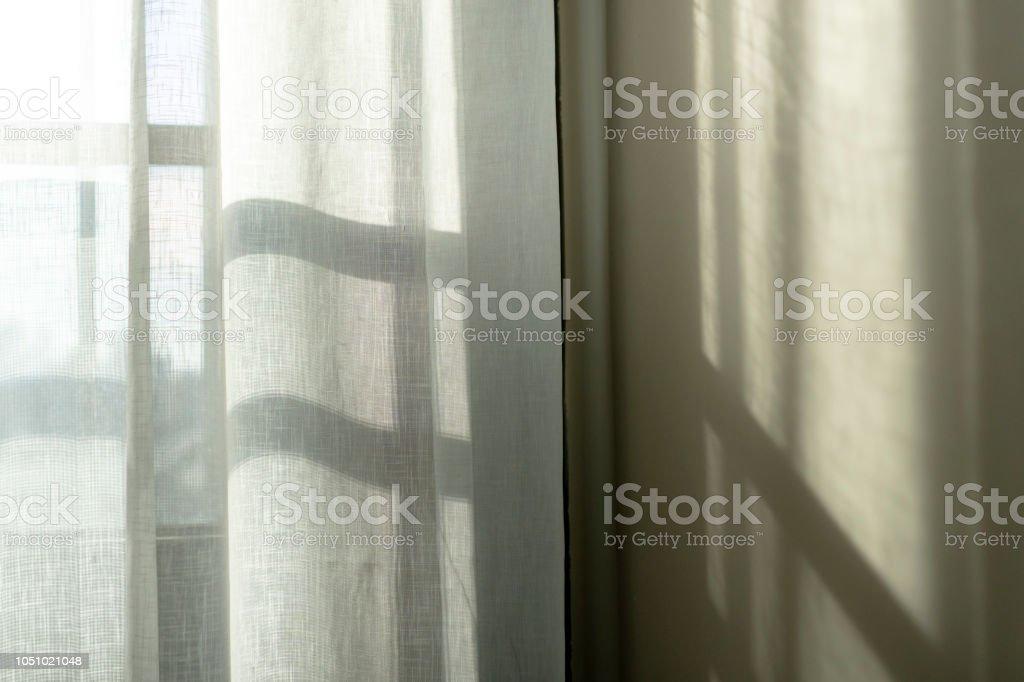 sunlight shadow through window stock photo