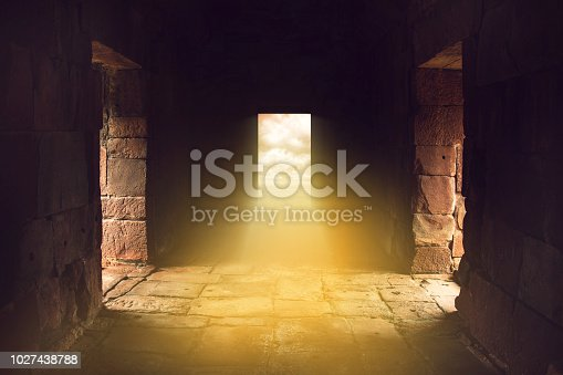 istock sunlight shines through the door in the end of ancient stone temple, travel in mysterious land. 1027438788