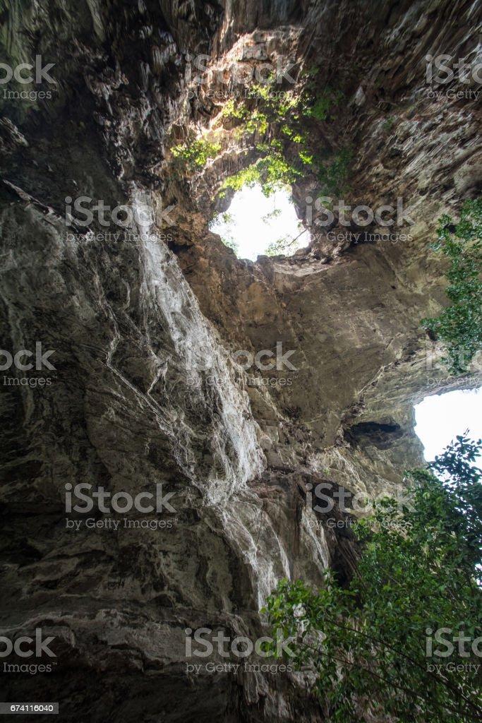 Sunlight shines through the  Than Lot Yai Cave ( Chaloem Rattanakosin National Park ) , Kanchanaburi, Thailand royalty-free stock photo