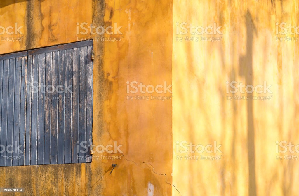 Sunlight shining on ochre walls stock photo