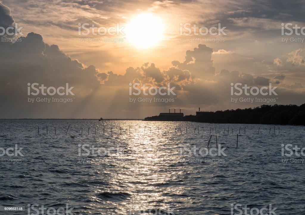Sunlight shining sea at sunset stock photo