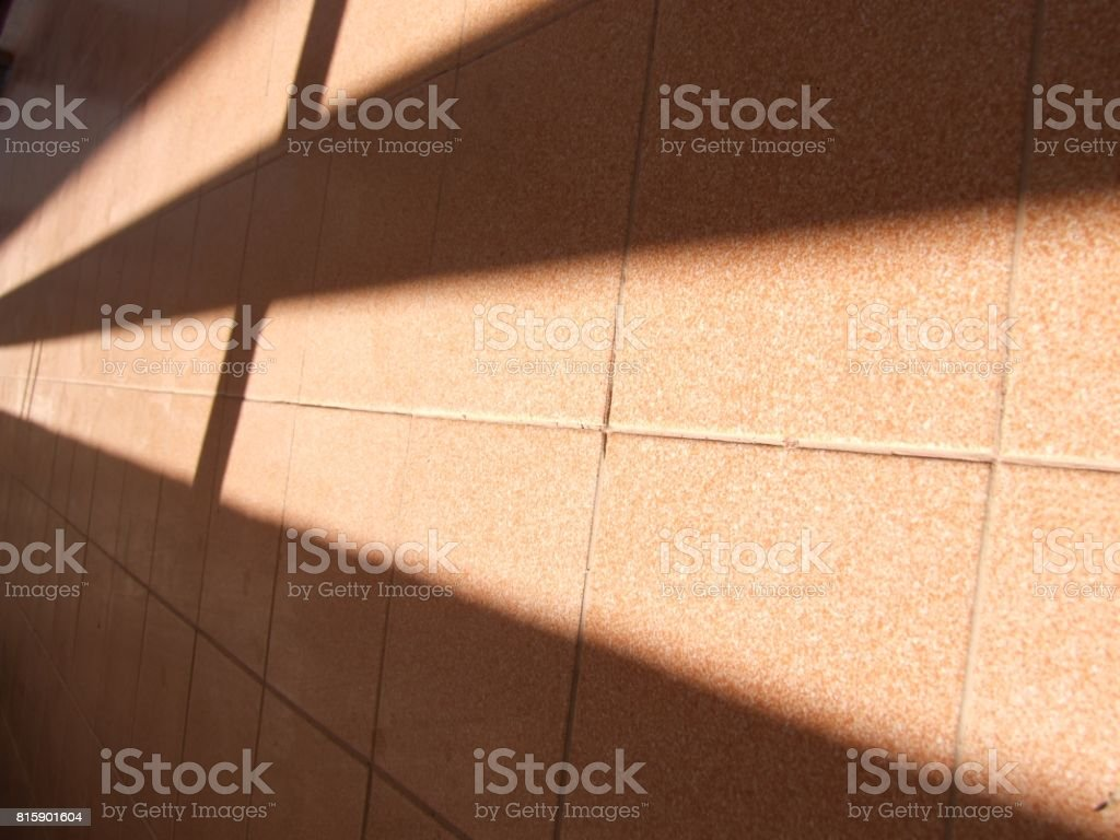 Sunlight streams  on to  floor stock photo