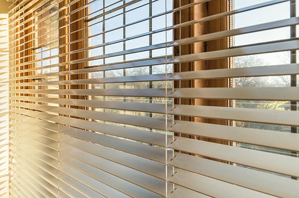 sunlight through blinds - blinds stock pictures, royalty-free photos & images