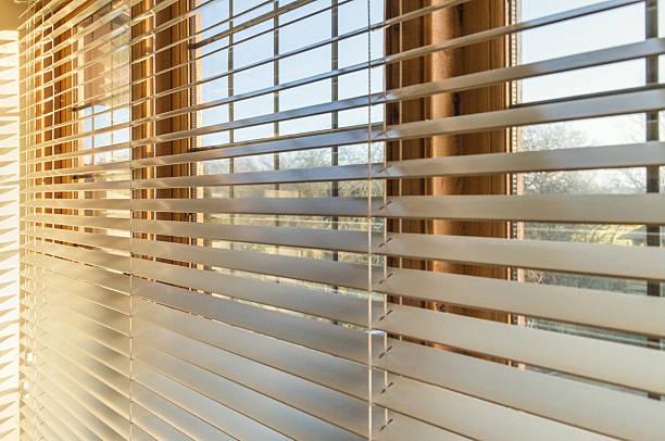 Sunlight through blinds stock photo