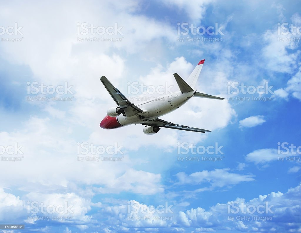 Sunlit airplane and blue sky royalty-free stock photo
