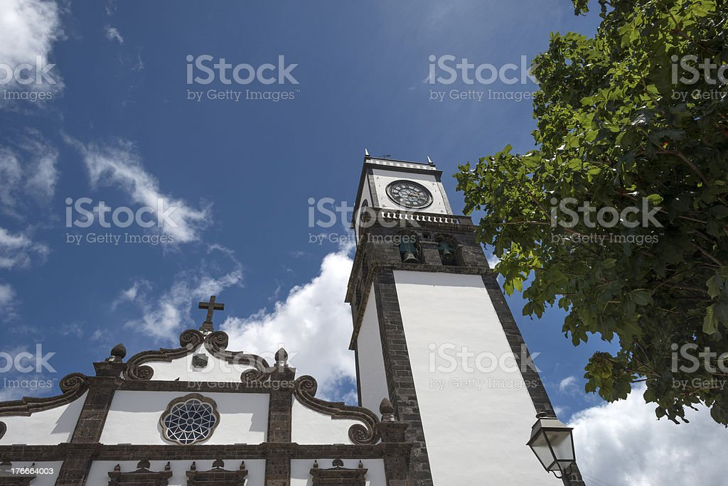Sunlit church tower in the Azores royalty-free stock photo