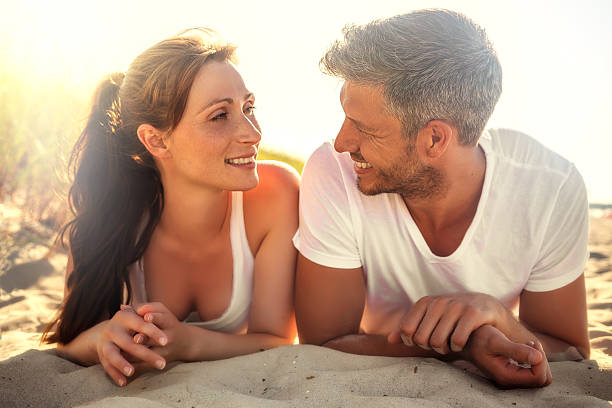 sunlit couple after sports stock photo
