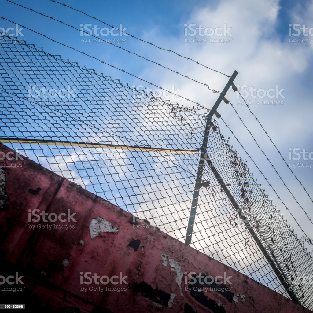 Sunlit fence with blue sky. royalty-free stock photo