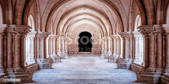 istock Sunlit gothic corridor cathedral courtyard. Wallpaper 1276599065