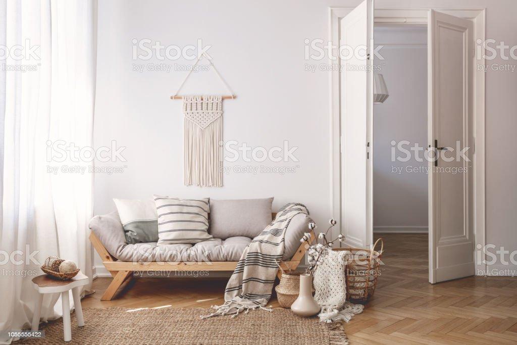 Sunlit Living Room Interior With Open Door, Herringbone Parquet Floor,  Natural, Beige Textiles And White Walls   Stock Image .