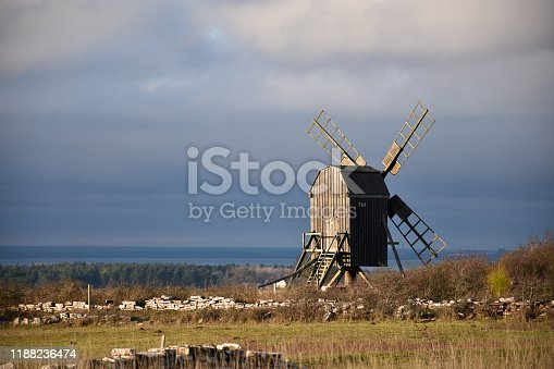 Sunlit old wooden windmill by fall season at the island Oland in Sweden