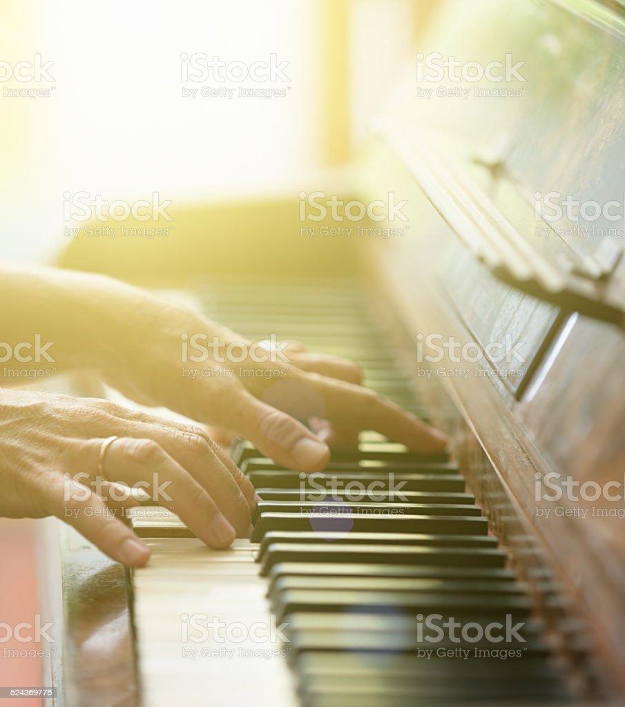 Sunlit piano recital stock photo