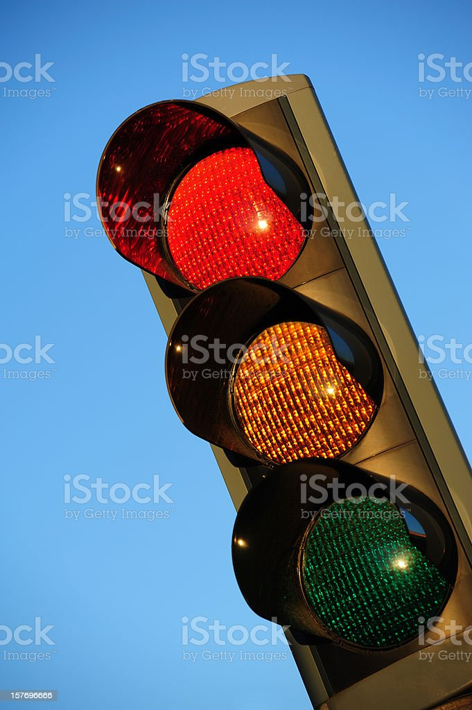 Sunlit red traffic light royalty-free stock photo
