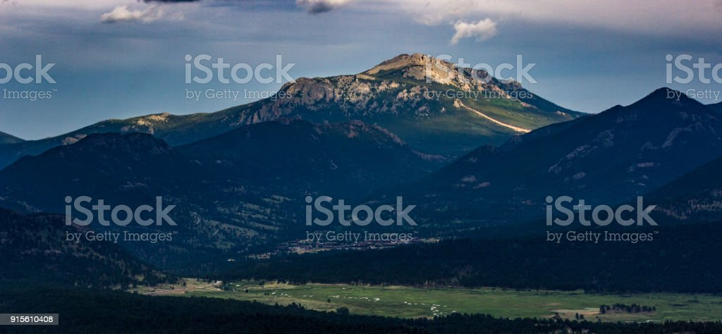 Sunlit Rocky Mountain Peak stock photo