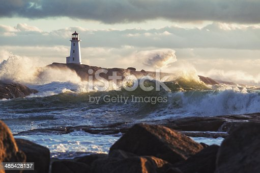 Heavy surf crashes ashore at Peggy's Cove Lighthouse during a strong Autumn storm.