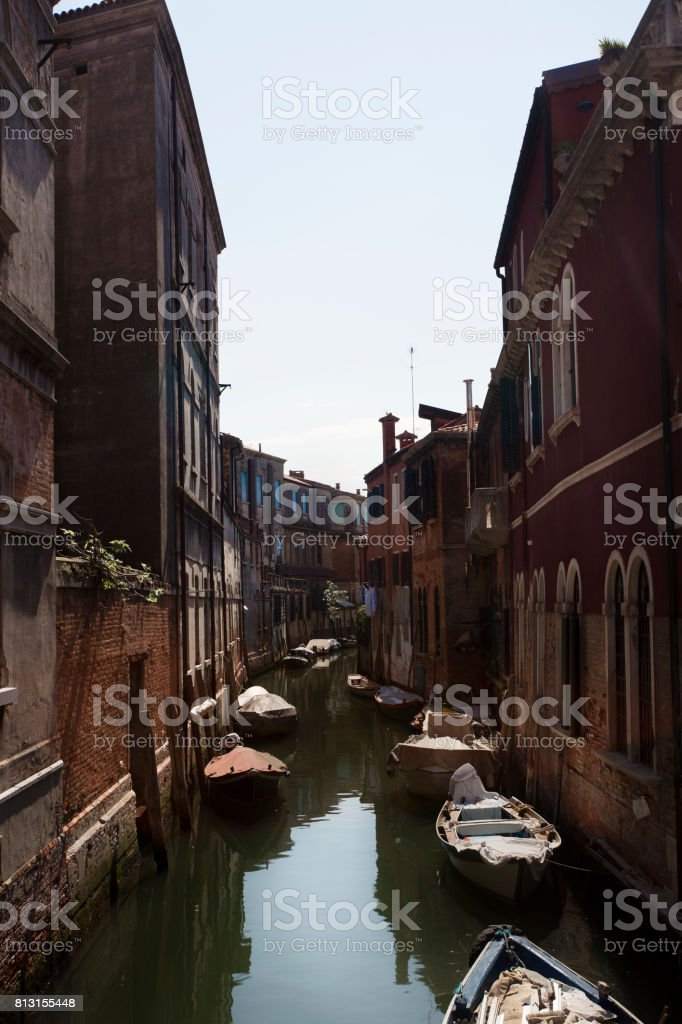 Sunlit Venezian Canal in Venice, Italy stock photo