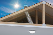 Sunlite light tube system for transporting natural daylight from roof into room. 3D rendered illustration.