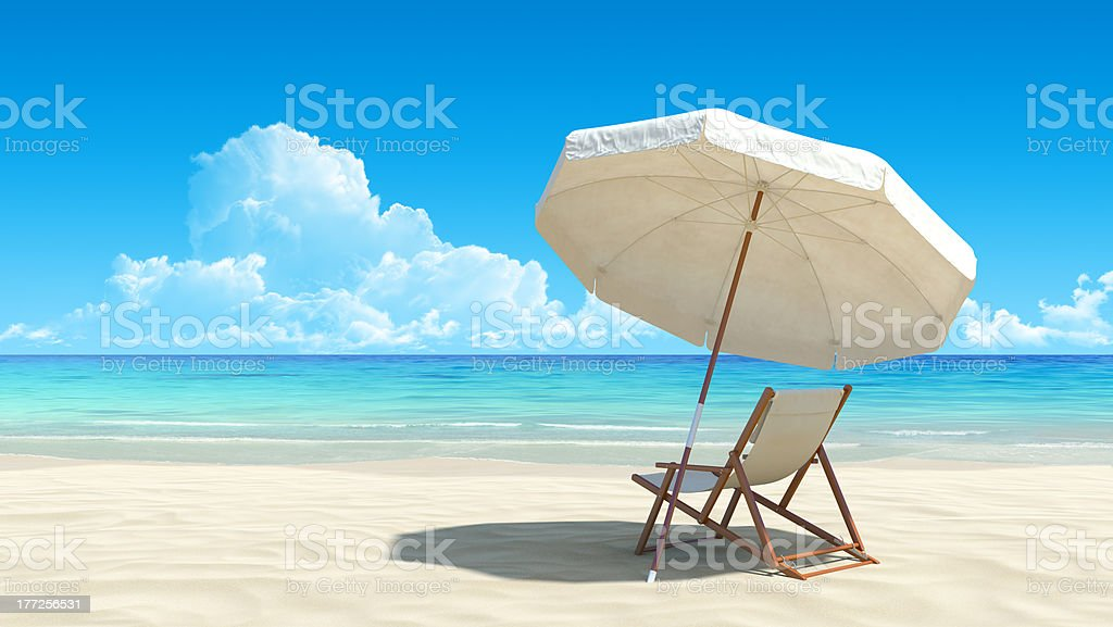 Sunlounger and umbrella on deserted tropical beach stock photo