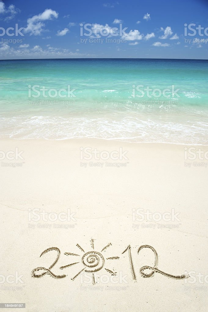 Sunny 2012 Message in Sand on Bright Tropical Beach royalty-free stock photo