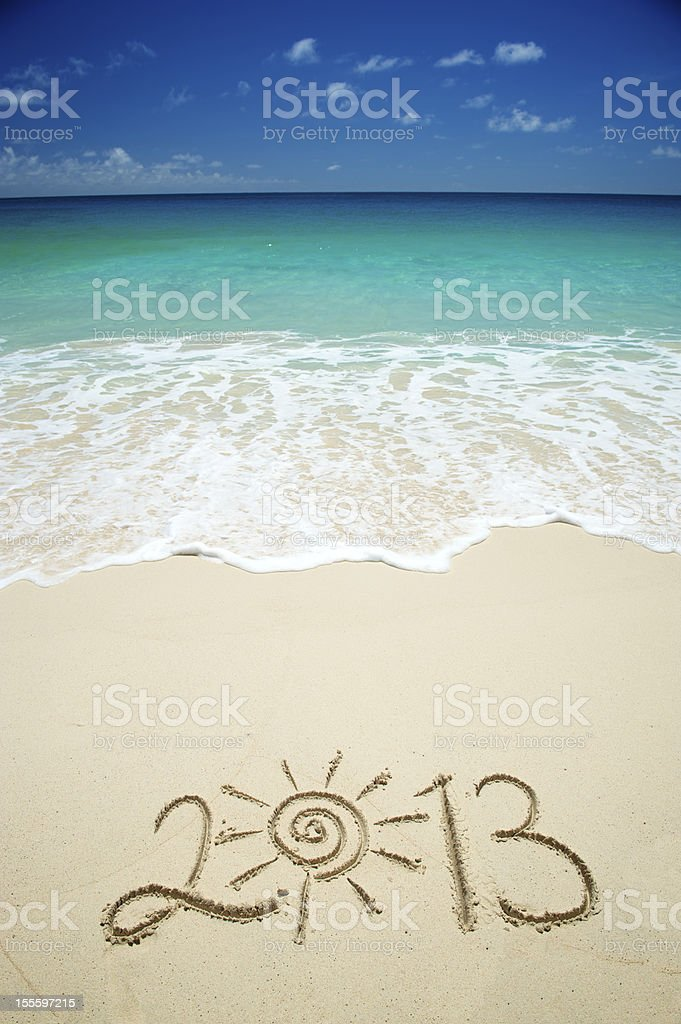 Sunny 2013 Message on Bright Tropical Beach royalty-free stock photo