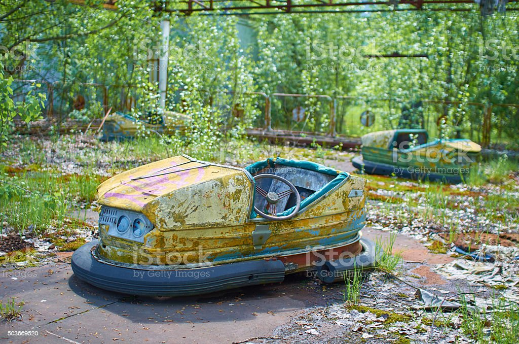 sunny abandoned soviet style classic car carousel playgroung in stock photo