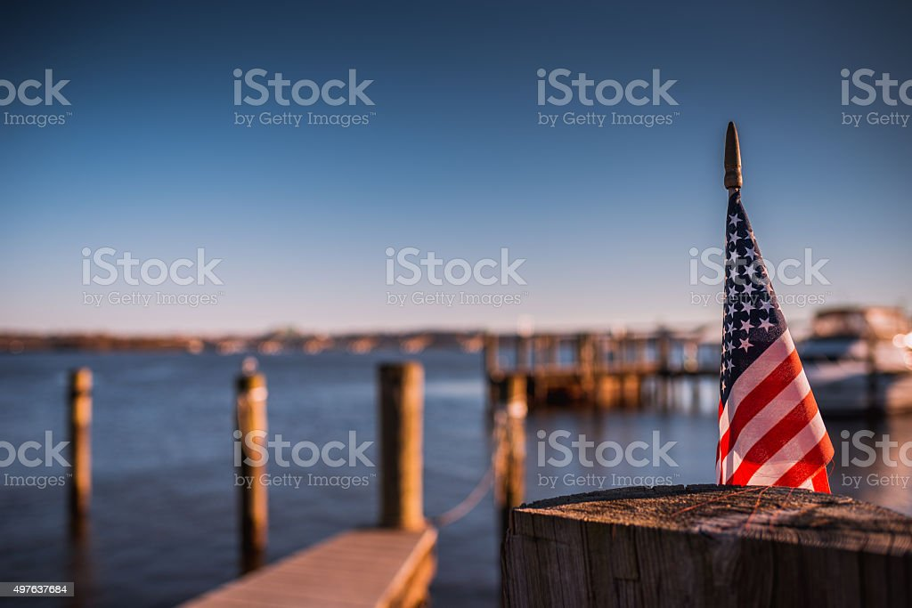 Sunny American Flag Riverside stock photo