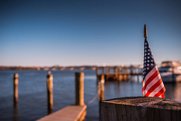 Sunny American Flag Riverside stock photo
