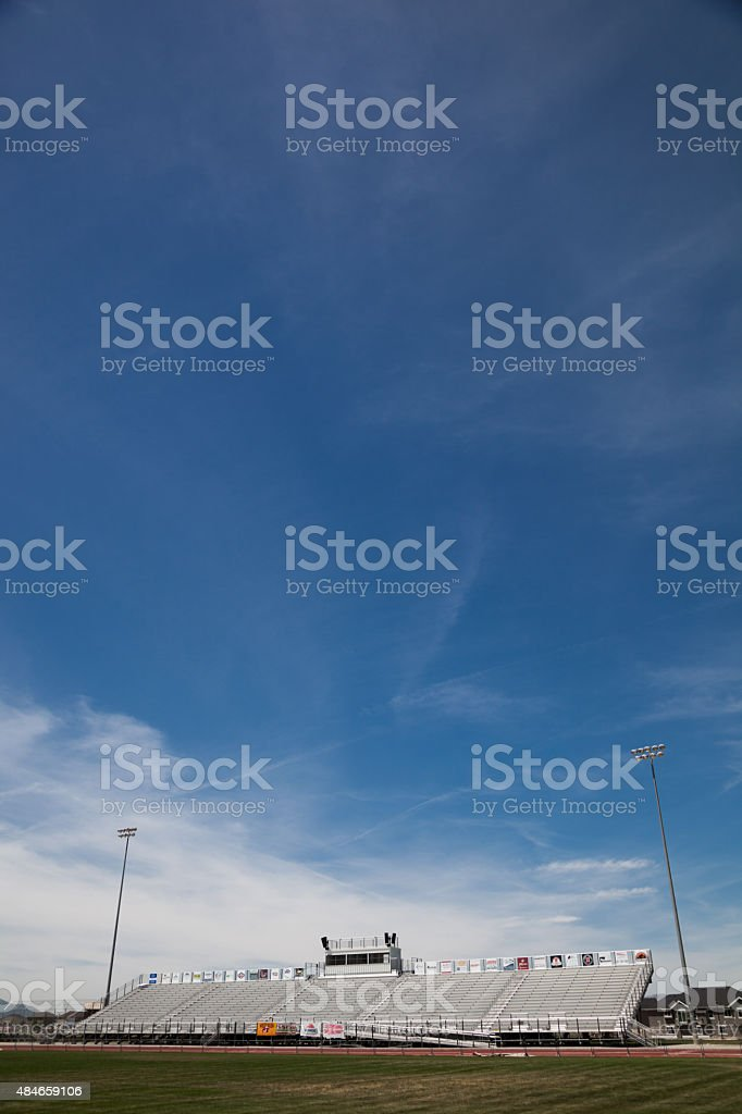 Sunny American stadium with  bleachers commentary box stock photo