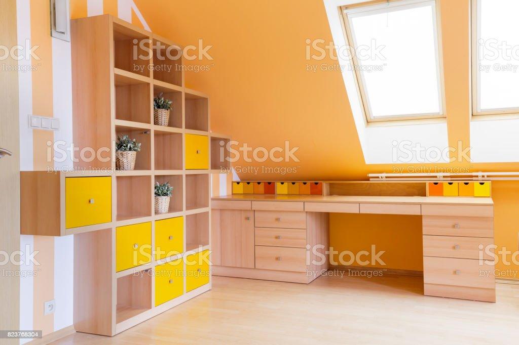 Sunny attic home office stock photo