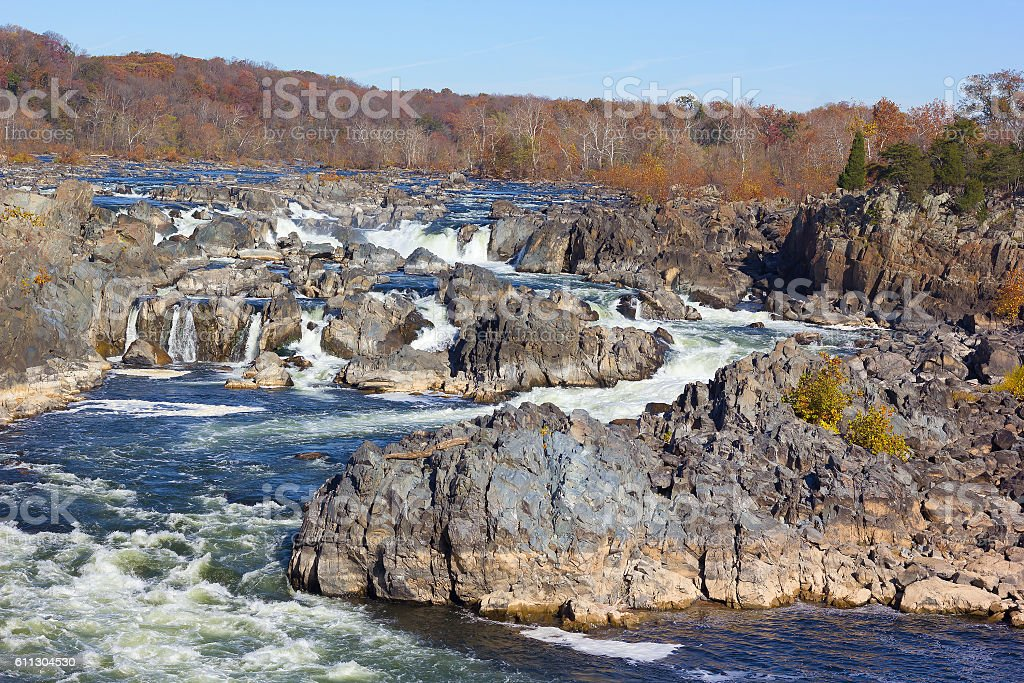 Sunny autumn morning in the state park near the waterfalls. stock photo