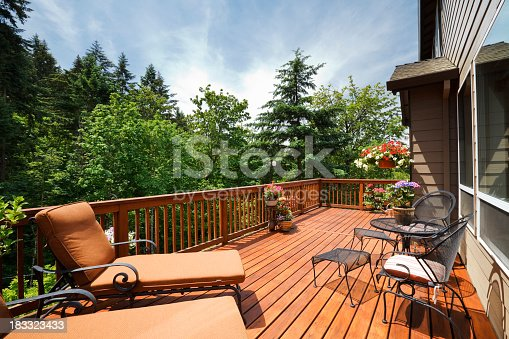 Sunny back deck with outdoor furniture.