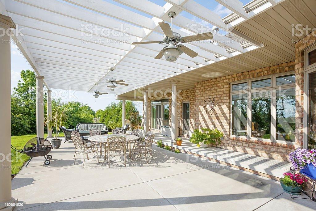Sunny Backyard Patio With Pergola stock photo
