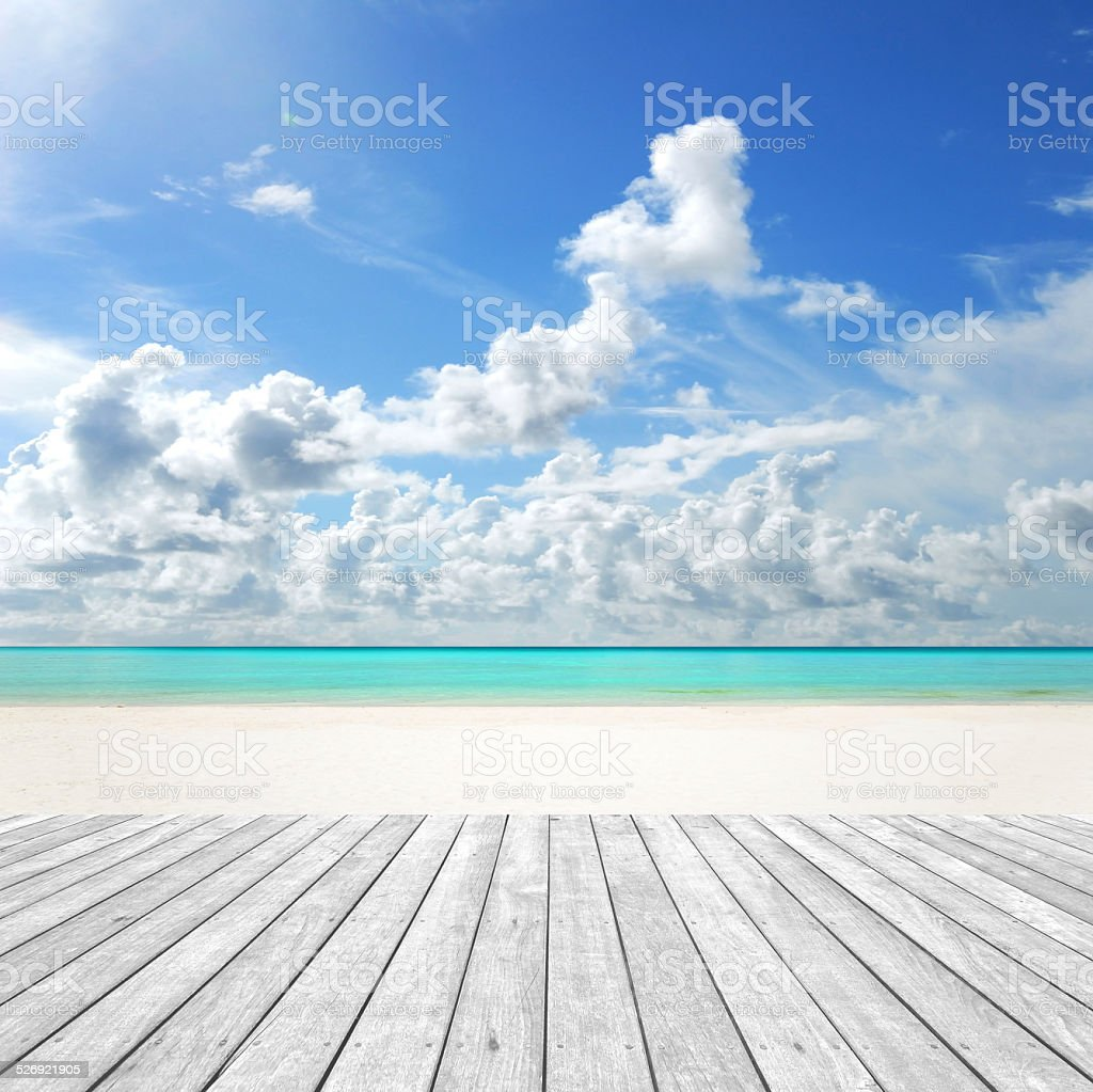 Sunny beach and empty wooden platform stock photo