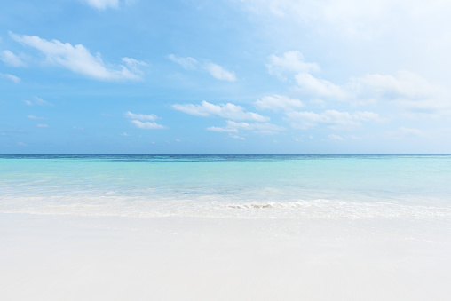 Sunny beach and turquoise sea with clear sky background