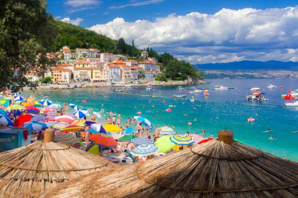 Sunny beach of Moscenisca Draga, in Croatia MOSCENISCA DRAGA, CROATIA - AUGUST 3. 2019 - Summer beach in Moscenisca Draga, in Croatia croatian culture stock pictures, royalty-free photos & images