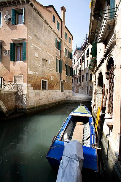 Sunny Canal in Venice Italy stock photo