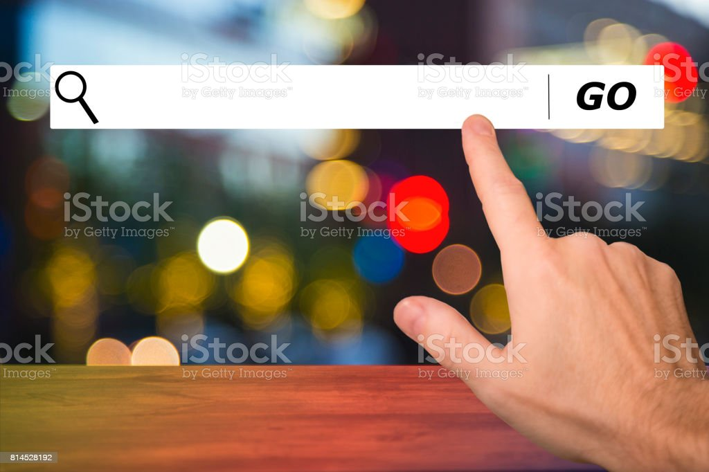 Sunny, cloudy blue sky with computer search bar and hand. stock photo