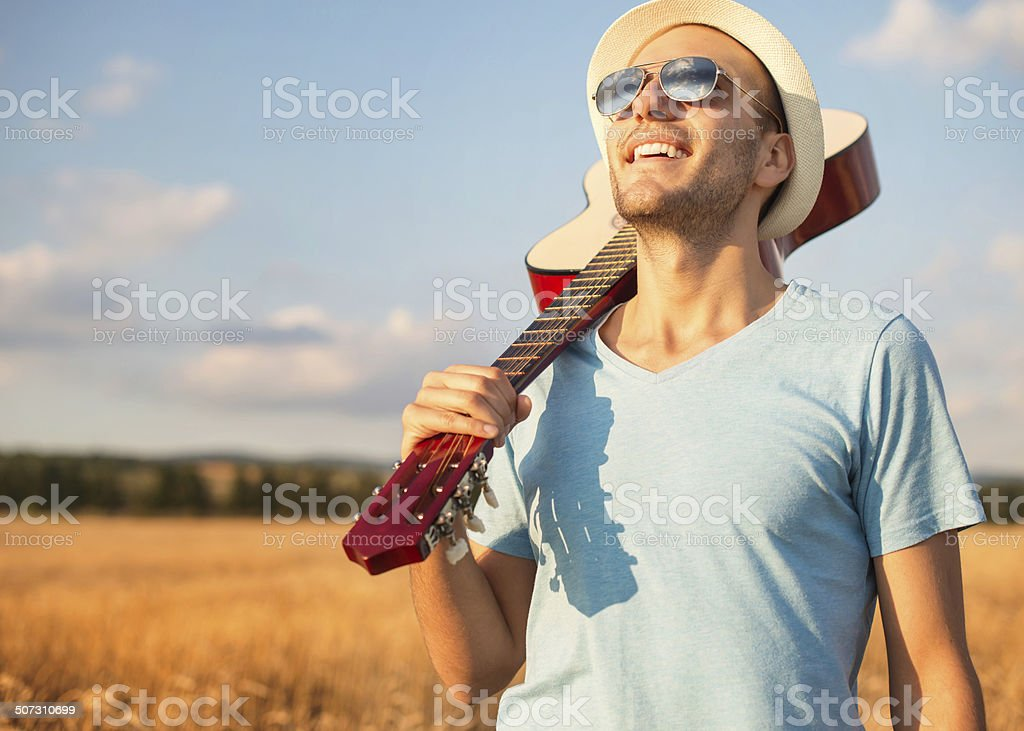 Sunny day and a guitar stock photo
