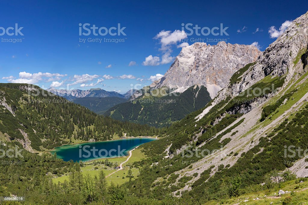 Sunny day at  Seebensee in Tirol with Ziugspitz in background stock photo