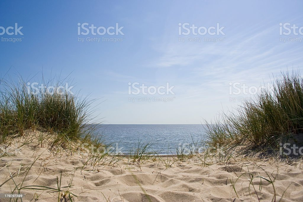 Sunny day at the beach, showing a patch down to the ocean  stock photo
