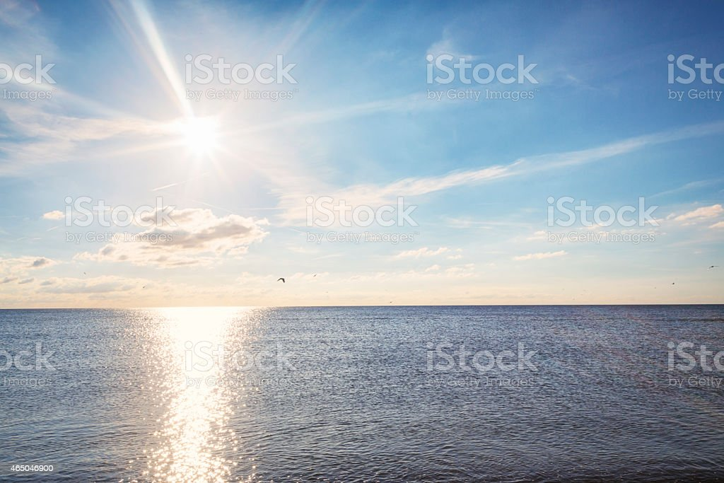 Sunny day by the water with sparkle lights stock photo