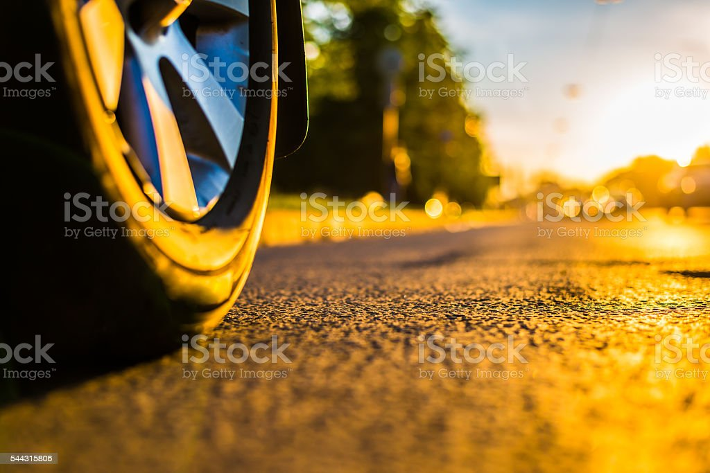 Sunny day in a city, headlights of approaching cars stock photo