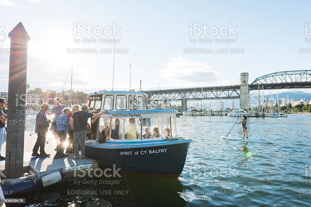 Sunny Day with False Creek Bay Ferry Boat Vancouver Canada stock photo