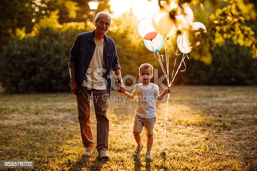istock Sunny day with grandfather in the park 959378202