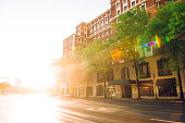 This is a horizontal, color photograph of a backlit street in downtown Chattanooga, Tennessee at sunset. Cars in background are motion blurred. Photographed with a Nikon D800 DSLR camera.