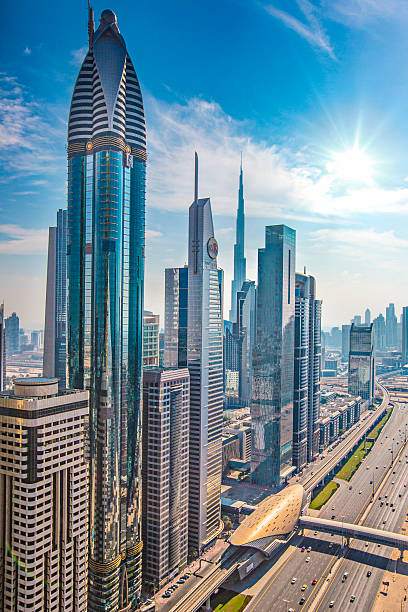 sunny dubai - sheikh zayed road stock-fotos und bilder