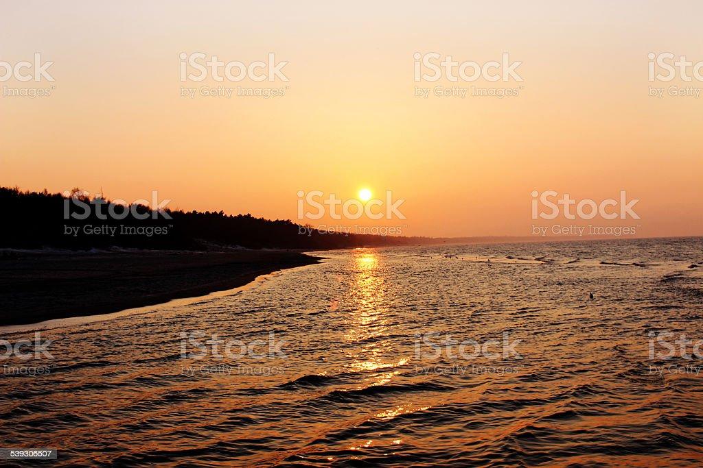 Sunny evening at baltic sea beach stock photo