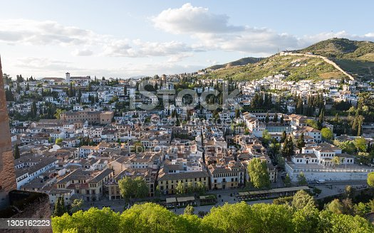 istock Sunny evening view on Granada city, seen from The Alhambra complex 1305162223