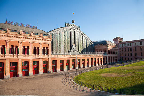 sunny facade of Madrid Atocha train station - foto de stock