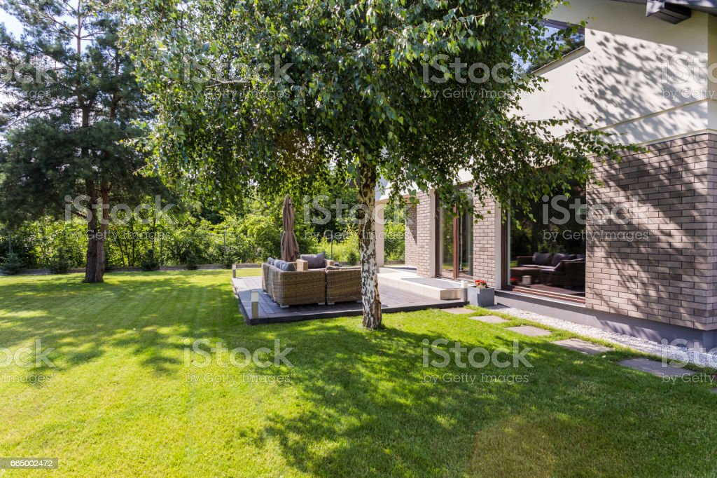 Sunny garden ideal for summer barbecues stock photo